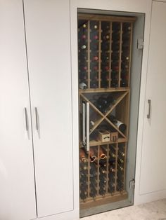 Bespoke solid oak featuring individual bottle hole storage, a cellar cube and sat on a provided plinth. The customer had already installed the eye catching glass door. All of the wine racking supplied by Wineware in the UK. Wine Storage Cabinets, Wine Bottle Storage, Wine Rack Cabinet, Wine Shelves, Wine Rack Wall, Wine Cellar Modern, Wine Cellar Design, Wine Racks Uk, Built In Wine Rack