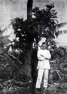 Self-portrait of Arthur Rimbaud standing in front of a tree in Harar, c. 1883.