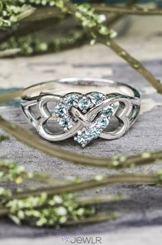 The Triple Heart Infinity ring is the perfect gift for someone you love. Personalized with your choice of metal birthstones and a special engraving along the band, she'll never want to take it off! Order at jewlr.com for free shipping and a free gift with your purchase.