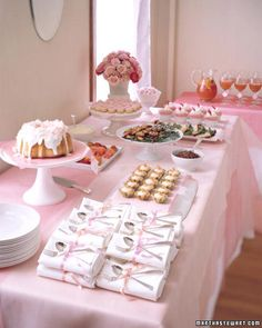 Baby Girl Shower Idea: The table is draped with pink fabrics; offerings on the buffet include fresh-fruit skewers, salmon mousse tartlets, balsamic shrimp, and chicken salad with raspberries.