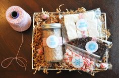 Hot Cocoa marshmallow gift package- I used bags and ribbon and I put some homemade dipped marshmallows and some on a candy cane stick, peanut butter, white chocolate and mini milk chocolate chips and some regular marshmallows with homemade hot cocoa mix.