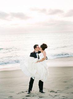 Bride and groom at their oceanside wedding.