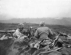 A machine gun nest and its resting crew Iwo Jima February-March 1945.