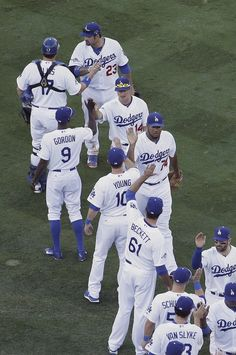 Los Angeles Dodgers slap hands after of Game 5 of the National League baseball championship series against the St. Louis Cardinals, Wednesday, Oct. 16, 2013, in Los Angeles. The Dodgers won 6-4 and trail in the series 3-2. (AP Photo/Morry Gash)