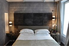 Double head board. Love the use of different greys.