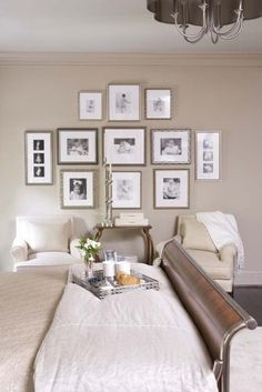 love this wall of pictures...traditional bedroom by Linda McDougald Design | Postcard from Paris Home