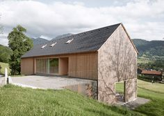 Wooden residence located in Austria's picturesque Bregenz Forest. Architecture Durable, Contemporary Architecture, Architecture Design, Roof Design, House Design, Haus Am Hang, Hillside House, Modern Barn, House In The Woods