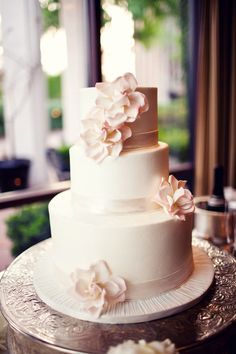 Typically not a fan of flowers on the cake, but I love how the flowers are a soft pink and it looks like ribbon wrapped around the layers.