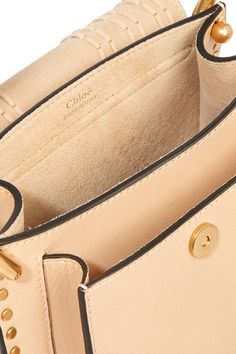 Sand leather and suede (Calf) Snap-fastening front flap Designer color: Pearl Beige Comes with dust bag Weighs approximately 2lbs/ 0.9kg Made in Italy