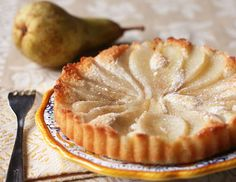 Pear Almond Tart:Ingredients: 5 Large Egg Whites 1/2 Cup Granulated Sugar 2/3 Cup Almond Flour (Or Similar In Finely Ground Almonds) 1/2 Cup Spelt Flour 1 Cup Melted Butter, Cooled 1 Teaspoon Almond Extract or Amaretto Liqueur 2 Large Ripe Pears, Poached (See Instructions Below) Topping: 1/3 Cup Sugar 1/2 Teaspoon Cinnamon