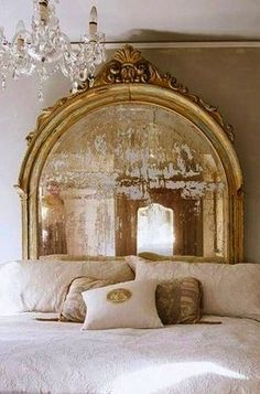 Antique mirror headboard. If you really want to be chic, you should have a chic home as well. Use feathers, metalic elements, fur and rich patterns at your bedroom, living room, kitchen, bathroom and even outdoors. Be elegant and see more decor tips, here: http://www.pinterest.com/homedsgnideas/