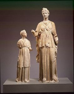 Toward the end of the fourth century B.C., Attic grave monuments became increasingly elaborate.  Freestanding figures such as these were often placed within a shallow, roofed, marble structure that was open at the front
