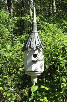 Welcome to our birdie paradise. This artisan made house greets you as you walk up to the entrance door. Every year the chickadee's make . Bird House Feeder, Bird Feeders, Outdoor Art, Outdoor Gardens, Bird Boxes, Garden Structures, Fairy Houses, Lawn And Garden, Yard Art