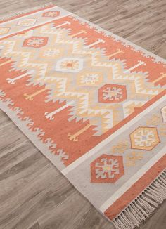 This indoor outdoor flatweave is inspired by the traditional kilims of the desert region, with both warm and bright colors.