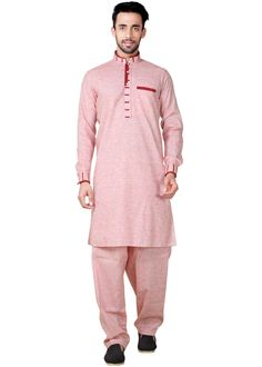 Readymade light #pink full sleeved linen #kurta enhanced by patch work and button down collared neck yoke. Comes with a matching #pathani #salwar in linen.