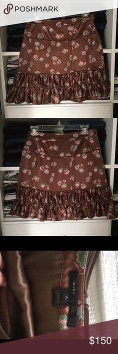 Marc Jacobs Skirt 100% silk Brown skirt with Floral design. Impeccable detail and in excellent condition! Open to reasonable offers through feature! Marc Jacobs Skirts
