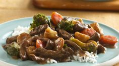 Enjoy a hearty Asian-style dinner!  Beef steak, vegetables and water chestnuts are slow cooked and served over rice!