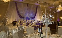 Toronto Wedding Decorations - Custom Backdrop and Head Table Draping Design by Mapleleaf Decorations in ROyal Purple, silver and white fabrics at Terrace Banquet Hall in Concord. Contact us for more info www.MapleleafDecorations.com
