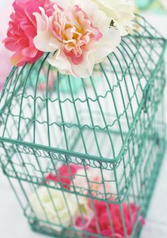 Love birdcages with flowers on them/in them.