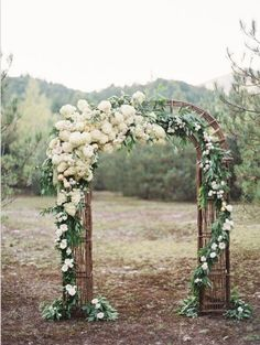 Beautiful flower ceremony arch...just add peacock featgers