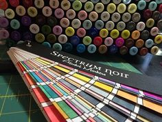 Not copic but I bet you could make this for copic!   ▶ Spectrum Noir Swatch Book - YouTube