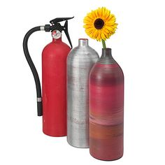 Recycled Fire Extinguisher Vase... wit one the babies old oxygen bottles...