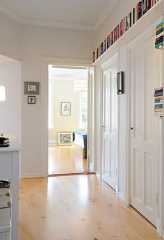 like the idea of shelves at above-doorway-level all around a room -- Drew needs book storage! Bookcase Door, Bookshelves, Barrister Bookcase, Comic Book Storage, Ceiling Shelves, Shelving, Shelf Design, Closet Designs, Closet Doors