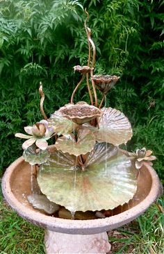 lotus pods leaves & flowers fountain. 60cm high by AnnieStorey, $490.00  **cg** Love these, she makes them from copper, silver, wire, steel, etc.