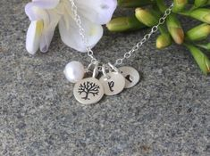 Family Initial Necklace, Tree,  Family  Tree Neckalce,Tree pendent, Tree of Life pendant personalized stamped discs,letter,Custom monogram by rainbowearring on Etsy https://www.etsy.com/listing/188704704/family-initial-necklace-tree-family-tree