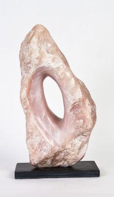 Soapstone on Slate base #sculpture by #sculptor Cynthia Lewis titled: 'Hole in Pink (Little abstract Carved Soap stone Indoors statuettes)'. #CynthiaLewis