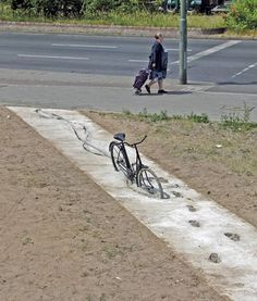 The footprints leading away from the bike are epic...Yeah, that's it. Let's walk the full length of the wet sidewalk.