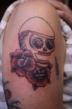 Teschio , rose e coppola, braccio