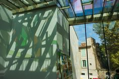 """""""The Violet Blue Green Yellow Orange Red House"""" by Raphael Hefti, an array of colorful laminated glass panels on the rooftop of the Fondation Vincent van Gogh Bookshop http://mikestravelguide.com/things-to-do-in-arles-visit-the-fondation-vincent-van-gogh-arles/ #art #Arles #France #travel"""