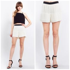 NWT Ivory pleated shorts XS/S/M/L Whitish cream in color with a black strip waste band. These shorts look gorgeous with a sheer black blouse or a pale pink over sized sweater. The pleats on the bottom of the shorts cause the shorts to flare loosely, which really complements a girls legs. Runs true to size.                            Please comment below with size you'd like and I'll create a separate listing for you      Please do not purchase this listing           ✅PRICE FIRM UNLESS…