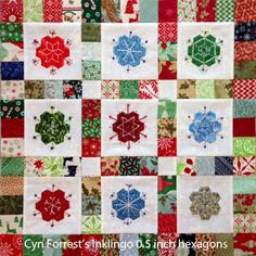 """Cyn wrote: """"I chose to use the Inklingo 1/2"""" Hexagon Collection instead of EPP for my hexie units. The hexies are appliquéed to BG blocks, then embroidered and beaded.  My design is inspired by """"Frosty Flakes"""" by Dawn Hay of """"As Sweet AsCinnamon"""" blog. It was a QAL in 2010.  The appliqué flowers in final border will be hexies--very very small ones. Probably 1/4 inch.""""  http://lindafranz.com/shop/hexagon-quilt-templates/5 A hexagon a day keeps the blues away!"""