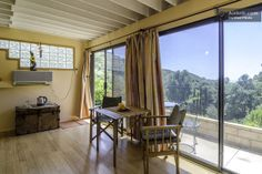 The views from the panoramic windows look out to the Pacific Ocean beyond the canyons.