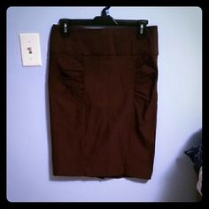 NWOT Chocolate brown pencil skirt Chocolate brown colored pencil skirt, never worn! Very flattering! Size 9. b wear Skirts Pencil
