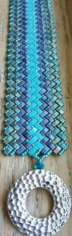 Very pretty Herringbone bracelet, made with Tila beads. https://www.etsy.com/listing/400704931/herringbone-tila-bracelet-miyuki-tila
