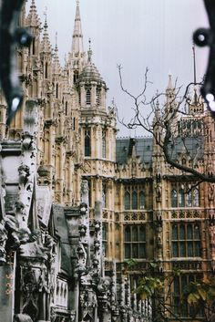 This Neo-Gothic masterpiece is the Palace of Westminster, London, and is where the House of Commons and the House of Lords (the two houses of Parliament of the UK) meet and debate. It lies on the Middlesex bank of the Thames.