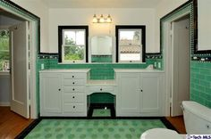 I love how the tiles frame the doorways in this 1928 vintage bathroom in South Pasadena. Plus those large penny tiles on the floor are amazing.