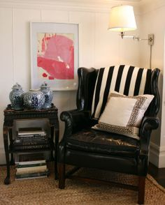 In his living room, Gibson added a dark leather wing chair—a flea market find—which he complemented with a painting made by a client's five-year-old child. The work's color and graphic quality appealed to him, and he asked if he could frame it.