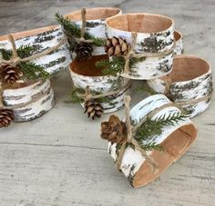 set of 8 Birch bark woodland napkin rings with Pine and cones.