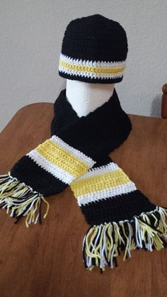 For a man or woman. Can be sold individually: Beanie: $20 Scarf:$25 Black, yellow and white. Perfect for football season!
