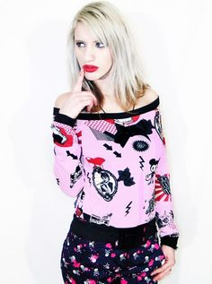 This is one of my all-time favourites.  Rockabilly Diva pink pinup long sleeve off shoulder by Agoraphobix, $40.00