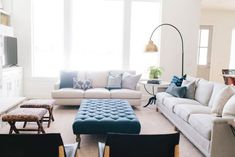 I have alternative thoughts to floor plan.  We can text or talk about it.  Pillows and Ottoman Add Pops of Color to This Bright Space