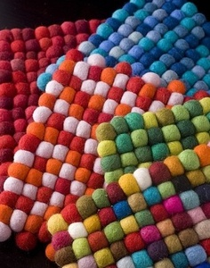 Sometimes I love felt, sometimes I don't. This felted-ball hot pad is a keeper. It's from Nepal, where it's sustainably made. That's nice.