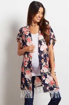 A gorgeous maternity kimono you can layer over all your basic pieces this year. A pretty floral print for a feminine look and a fringe trim detail for a touch of boho style. Layer this top over a maternity cami and pair with jeans for a complete ensemble you can wear from day to night.