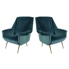 A Pair Of Italian Armchairs By Arflex  Italy  c.1950's  A pair of Italian armchairs by Arflex. Newly upholstered in blue ribbed velvet with contrasting gold velvet buttons.  c.1950's  Measure: 98cm high (backs) x 43cm high (seats) x 80cm wide x 73cm deep