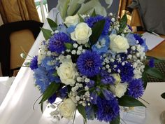 Really pretty posy with bright blue cornflowers, Gentians, Delphiniums, Gyp and small white Roses. perfect for a Summer Wedding.