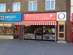 Shop awning powder coated red to match the shop front by Deans Blinds & Awnings